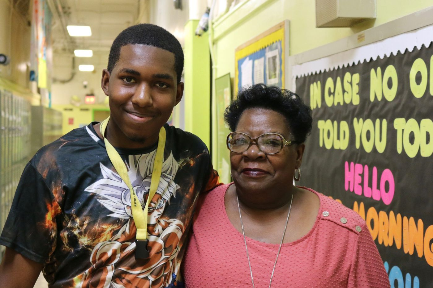 Student and parent smile for the camera