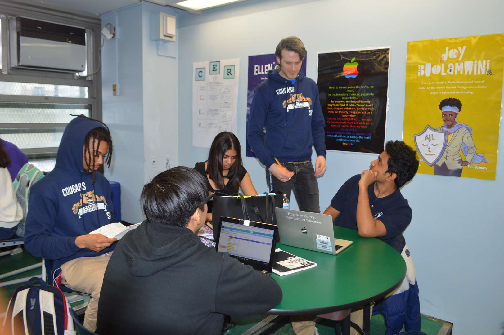 Students work in groups on their laptops