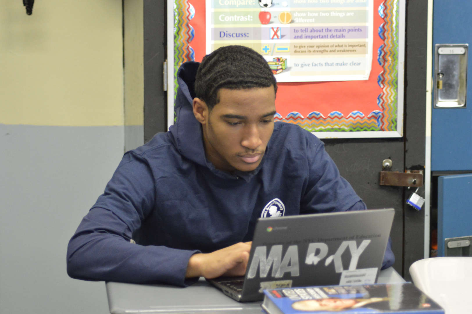 South Bronx Preparatory student works on laptop