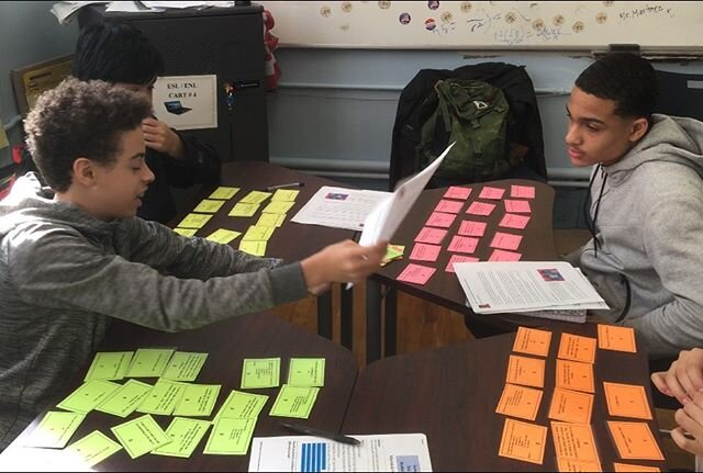 Students quiz each other using flashcards.