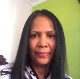Headshot of Evelyn De La Cruz