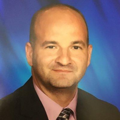 Headshot of Principal Kujtim Daliposki.