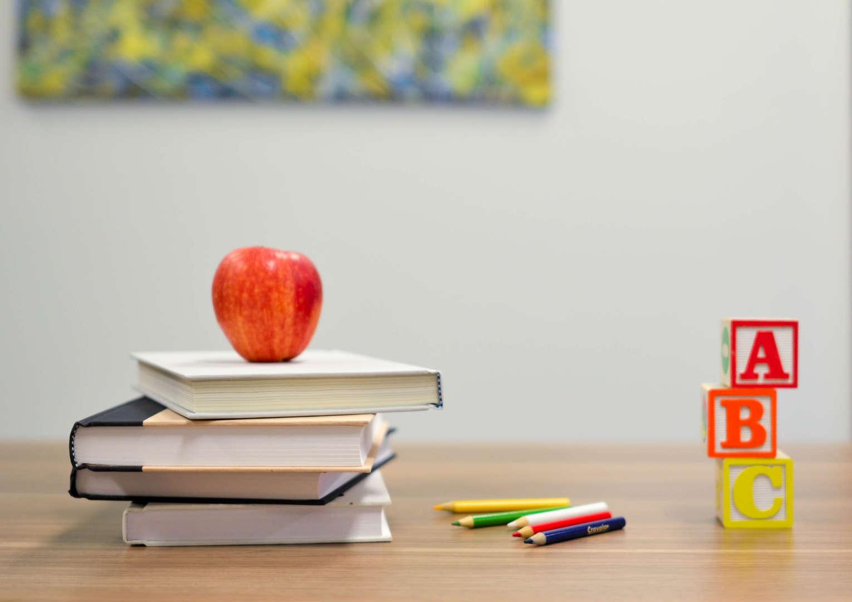 Apple and Books on Teacher's Desk