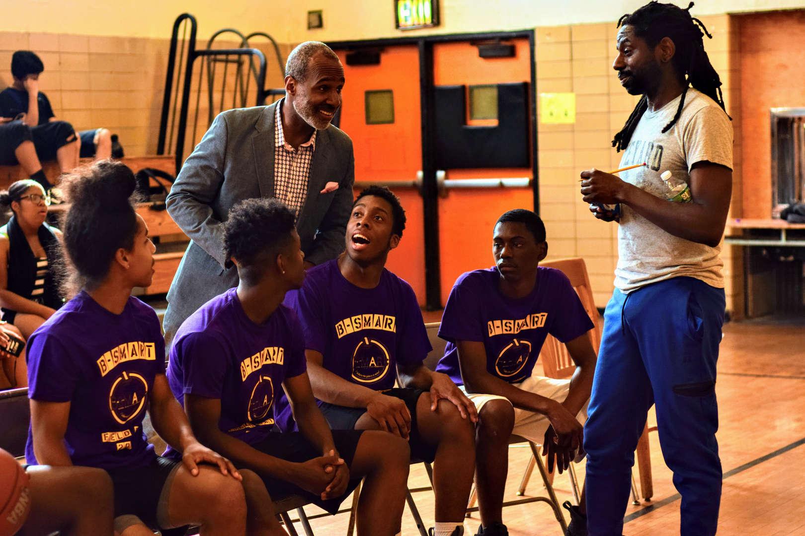Principal Rainey chats with the basketball team.
