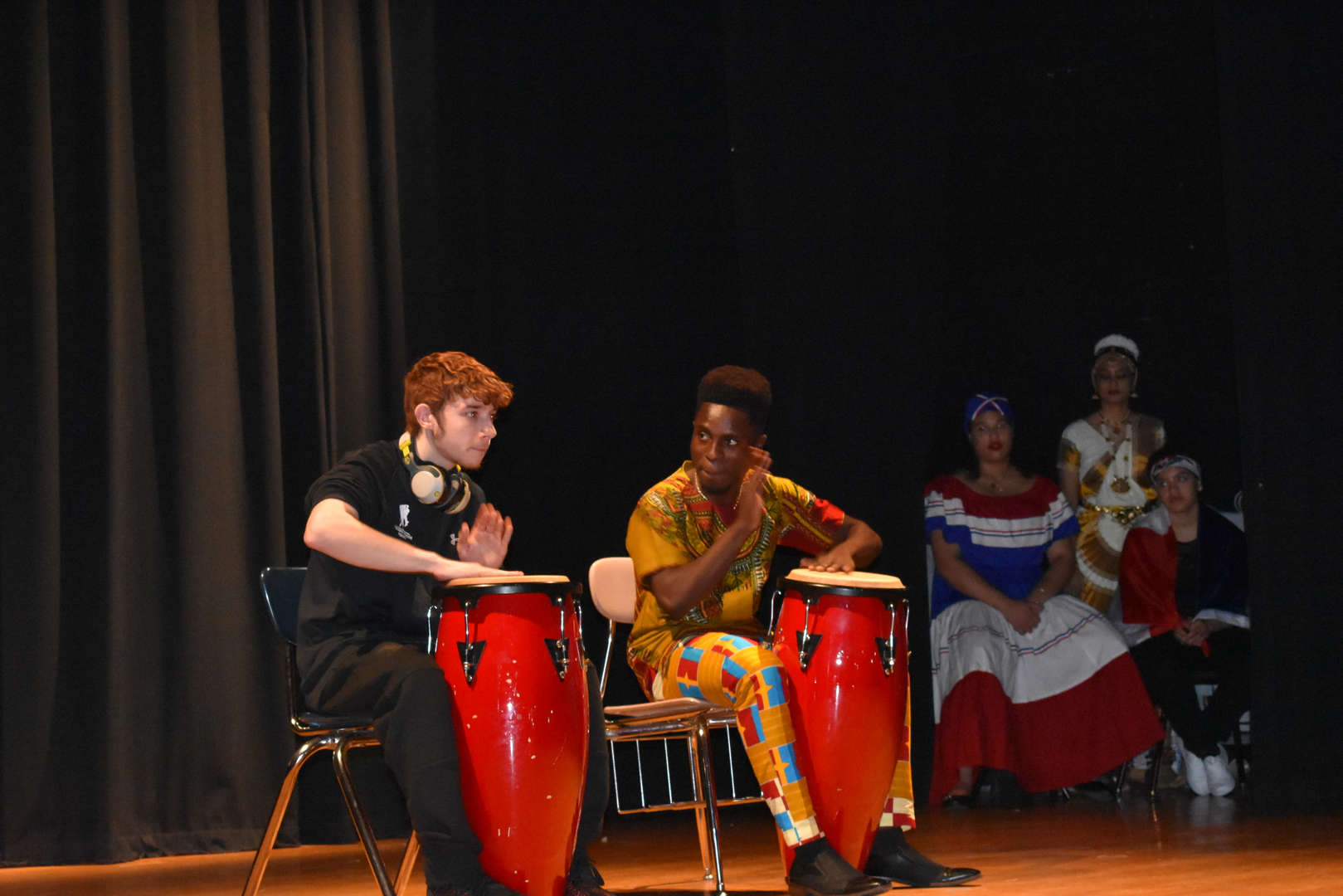 students play the bongo drums on stage