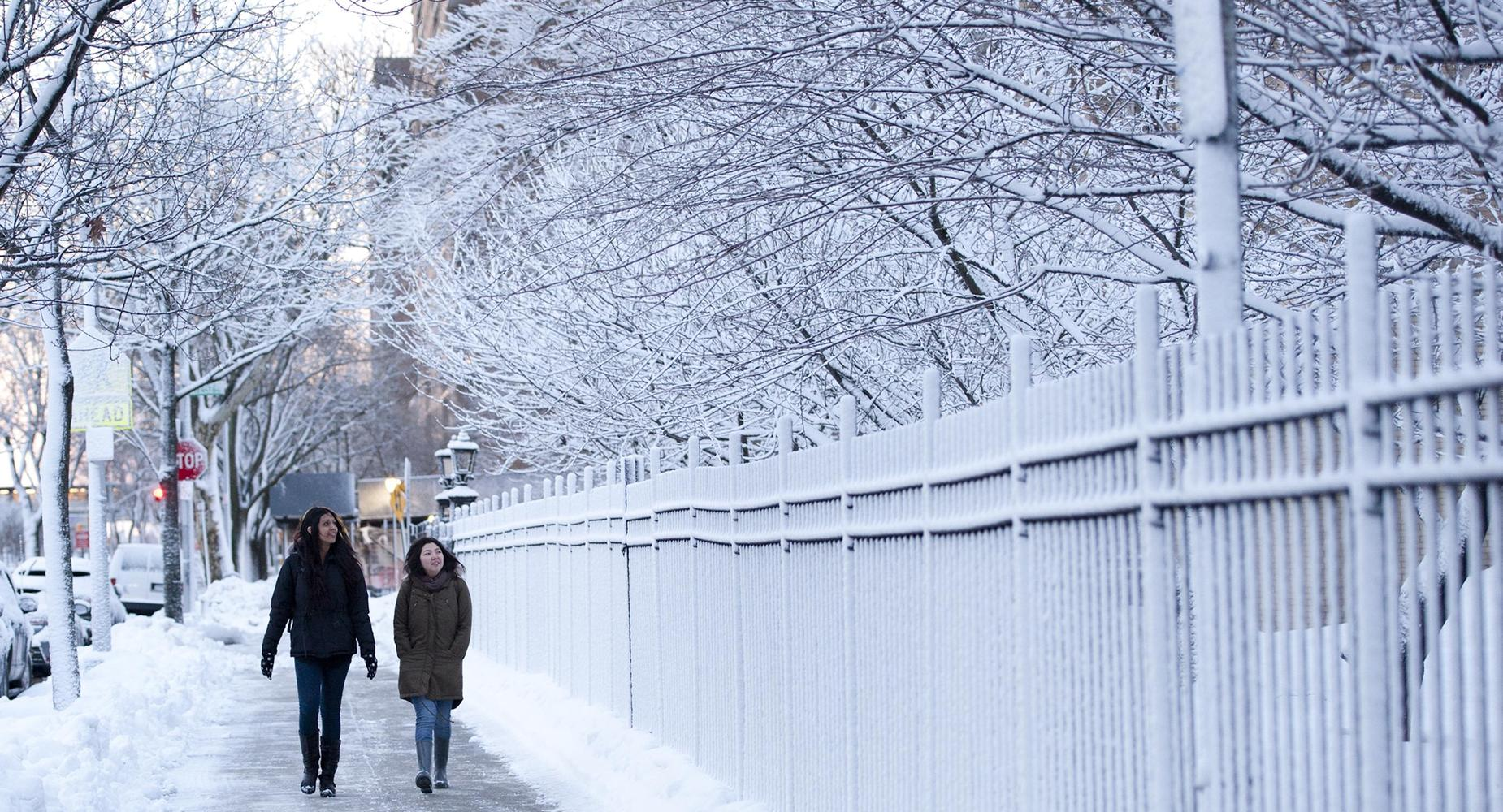 Students walking to school during the winter.