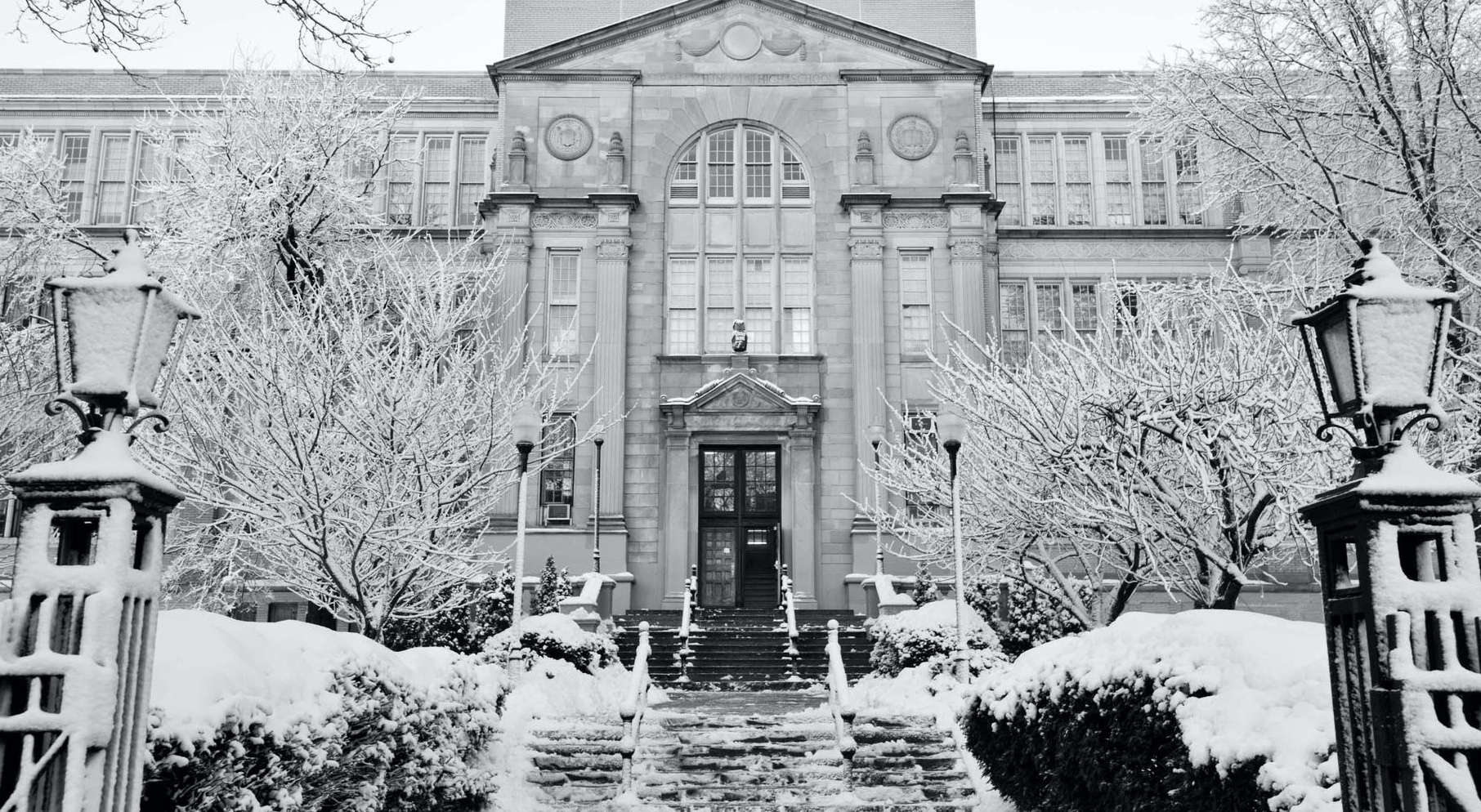 Abraham Lincoln High School Building Covering in Snow During the Winter.