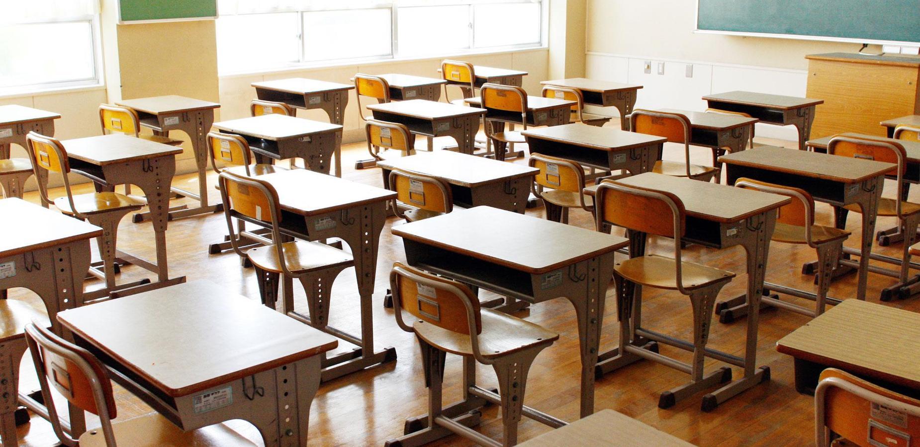 Student desks organized in rows.