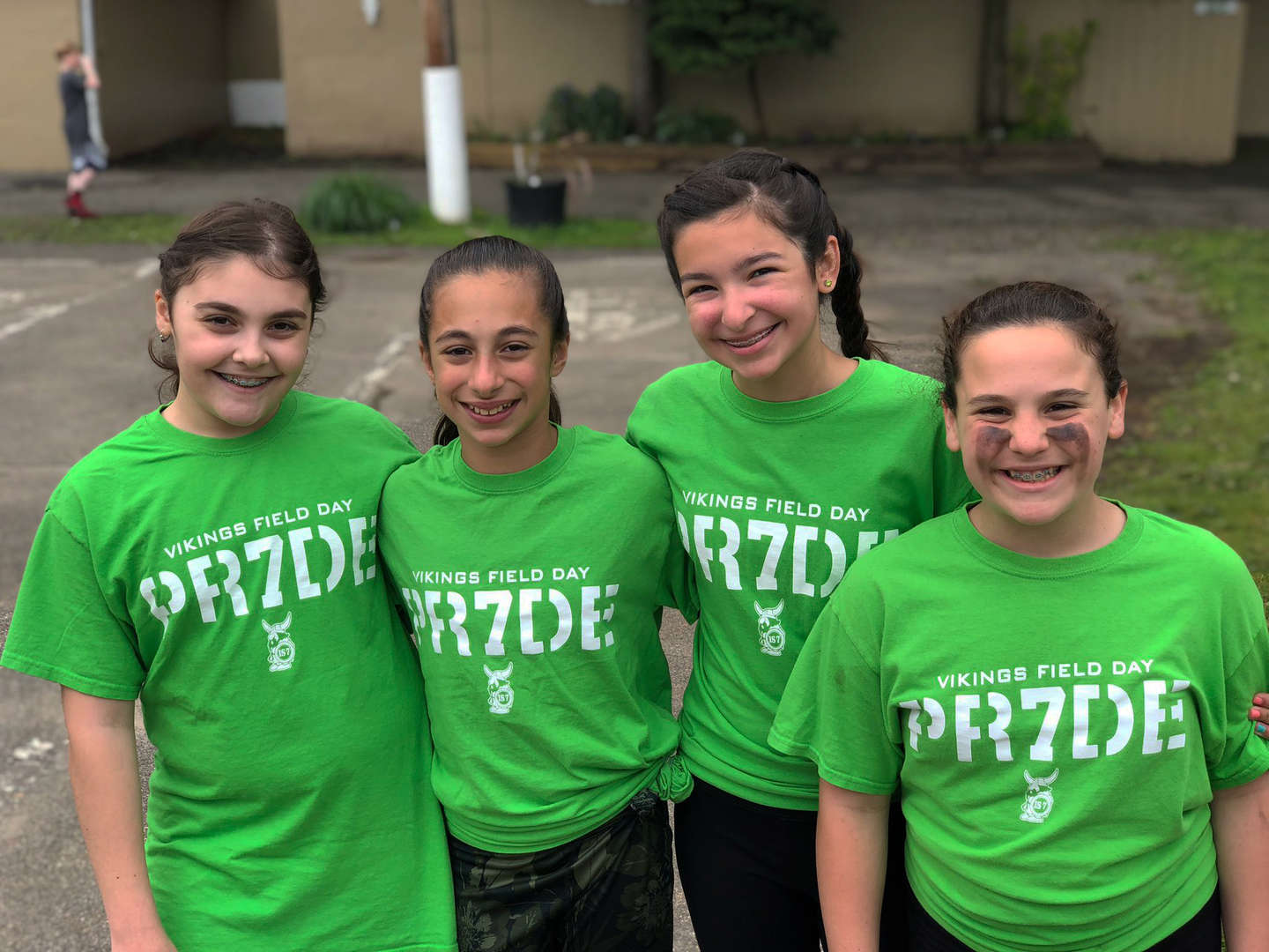 7th graders wear their green Vikings Field Day shirts for the I.S. 7 Field Day