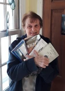 Mrs. Krieger holding books