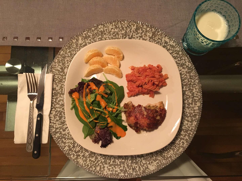 Pasta, chicken, salad and oranges