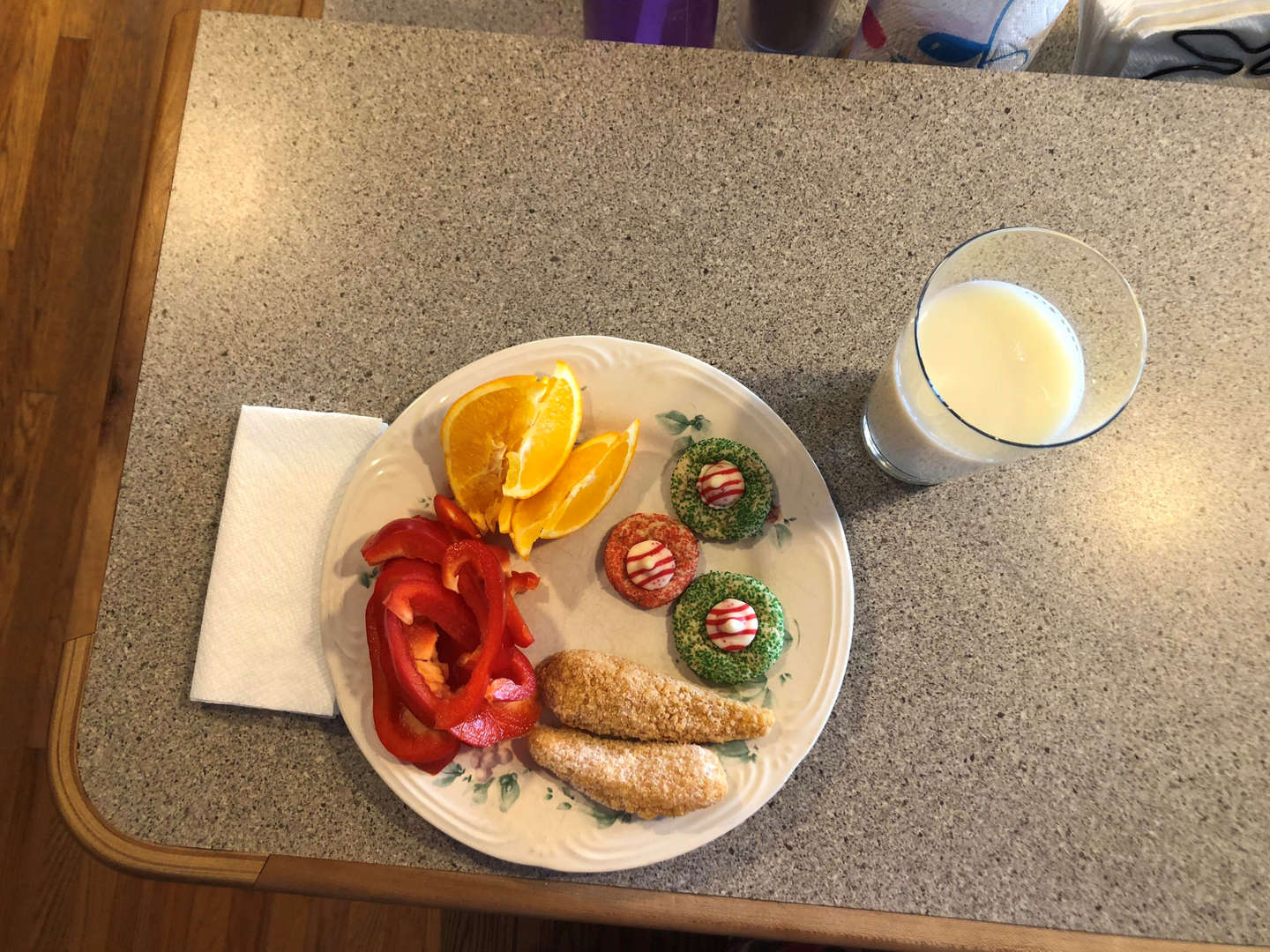 Red peppers, chicken tenders, oranges, milk and cookies (sweet treat on occasions)
