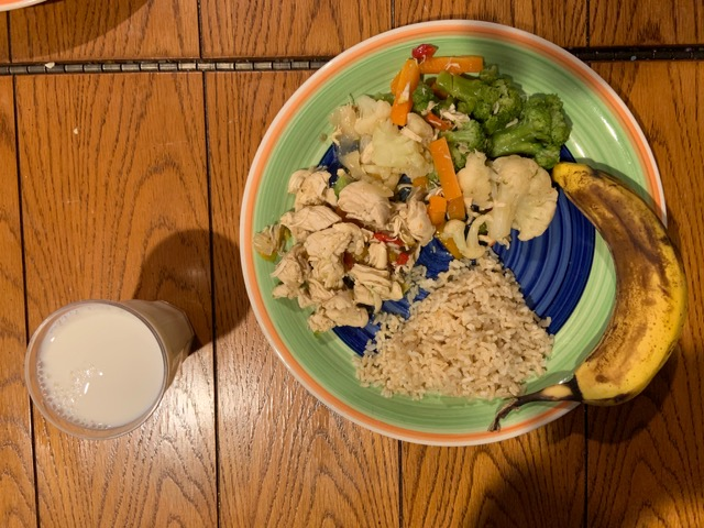 Chicken and rice, mixed vegetables and milk