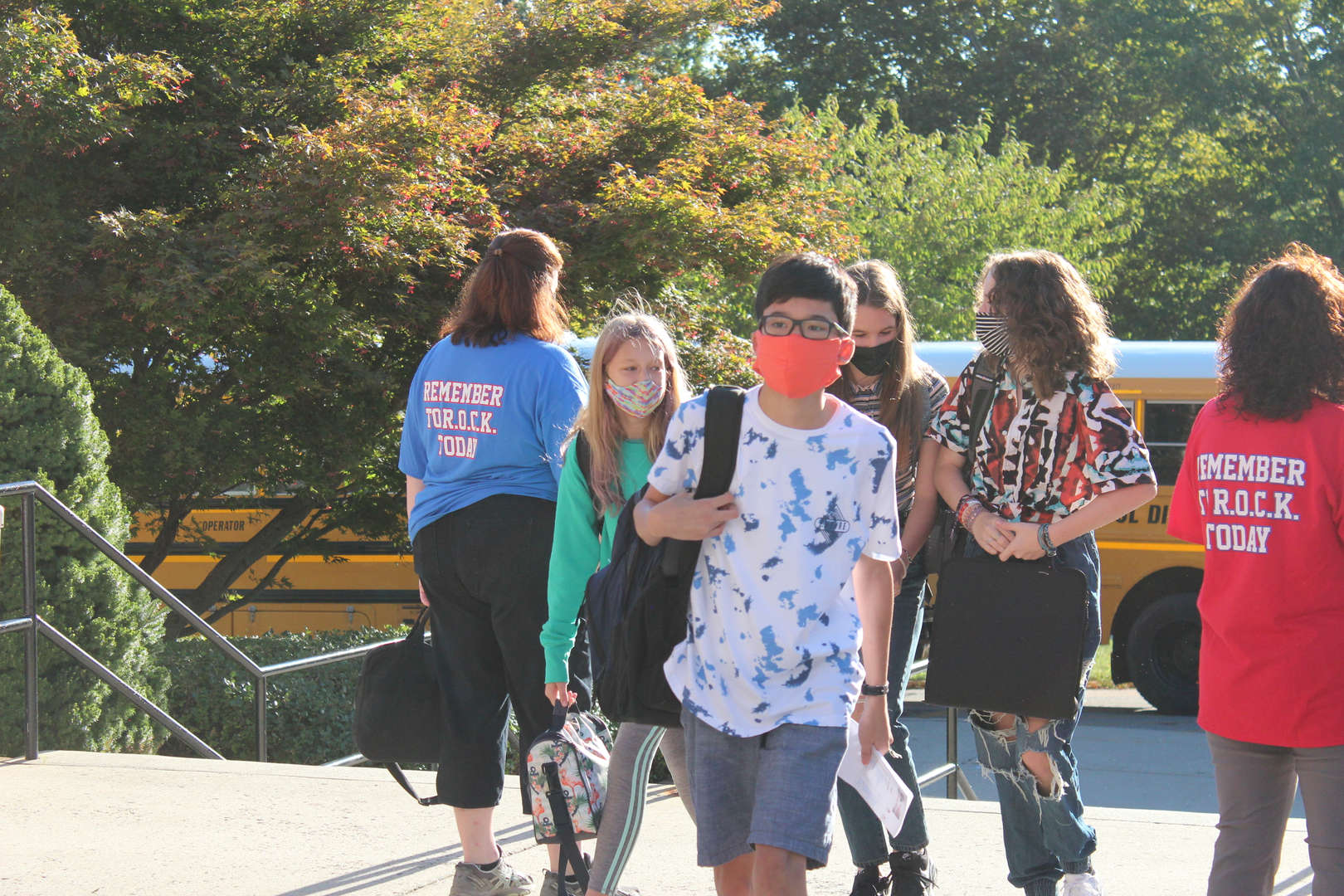 Students walk into the front entrance of George Fischer Middle School