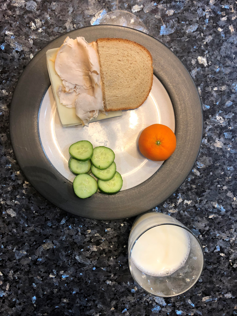 turkey sandwich, milk, cucumbers and milk
