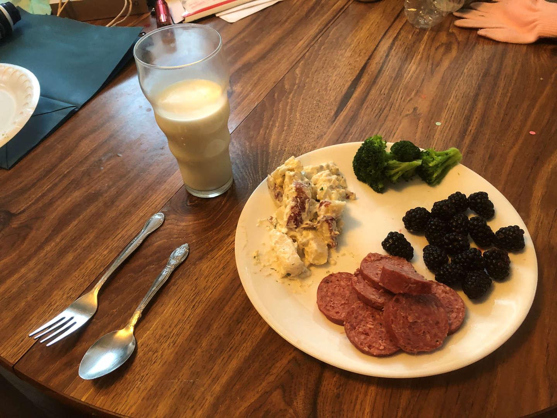 Kielbasa, red potato salad, broccoli and blackberries