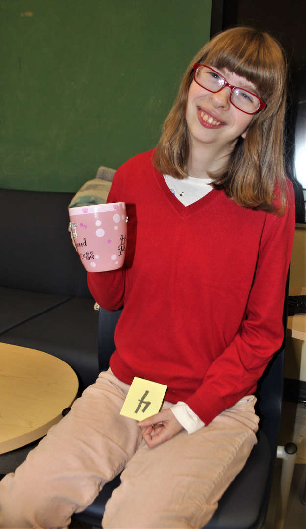 Photo of student holding the gift she chose for her mother.