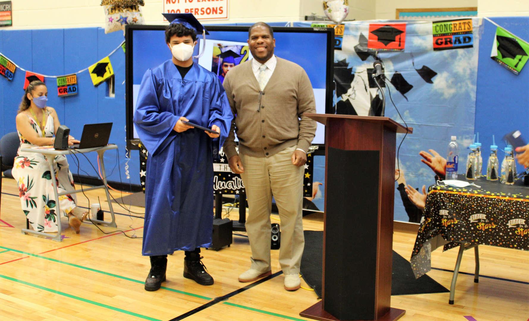 Rye Lake Middle/High School Principal Marvin Elliott poses with graduate David Nash.