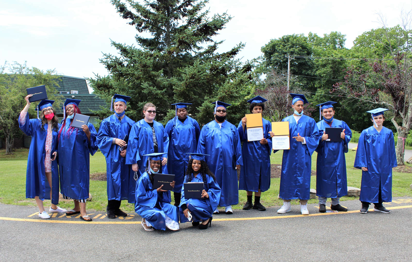 Members of the Class of 2021 pose for a photo after graduating.