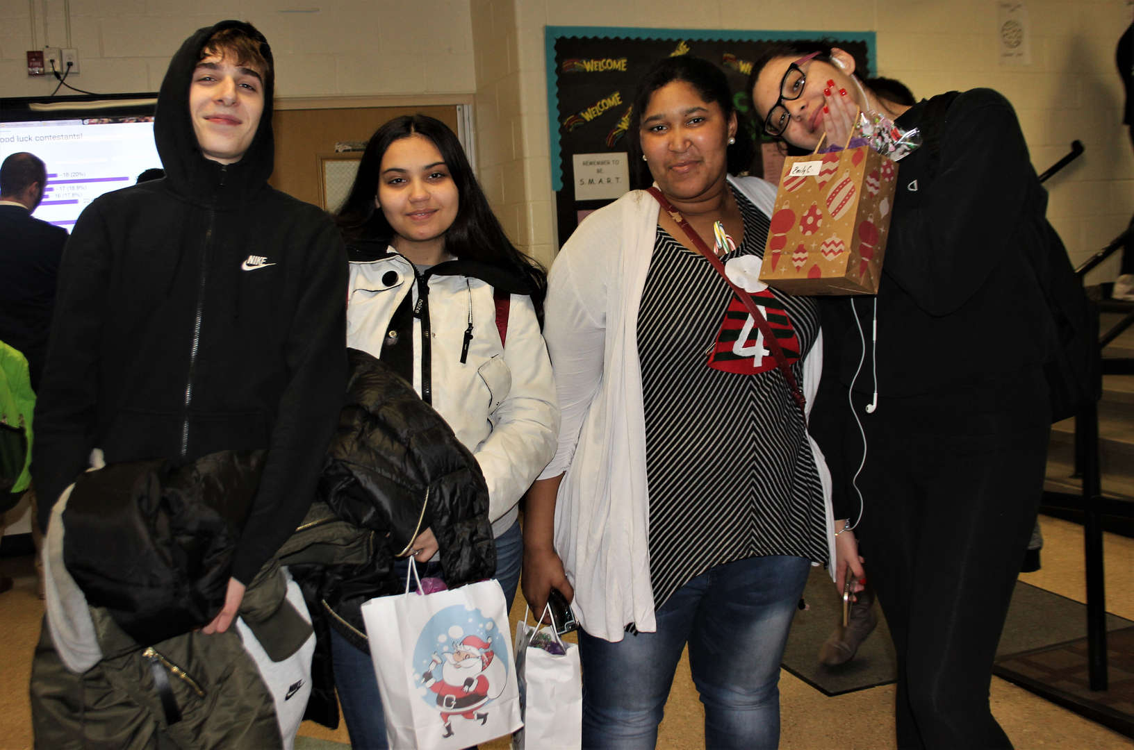 Picture of four students after they received their gift bags.