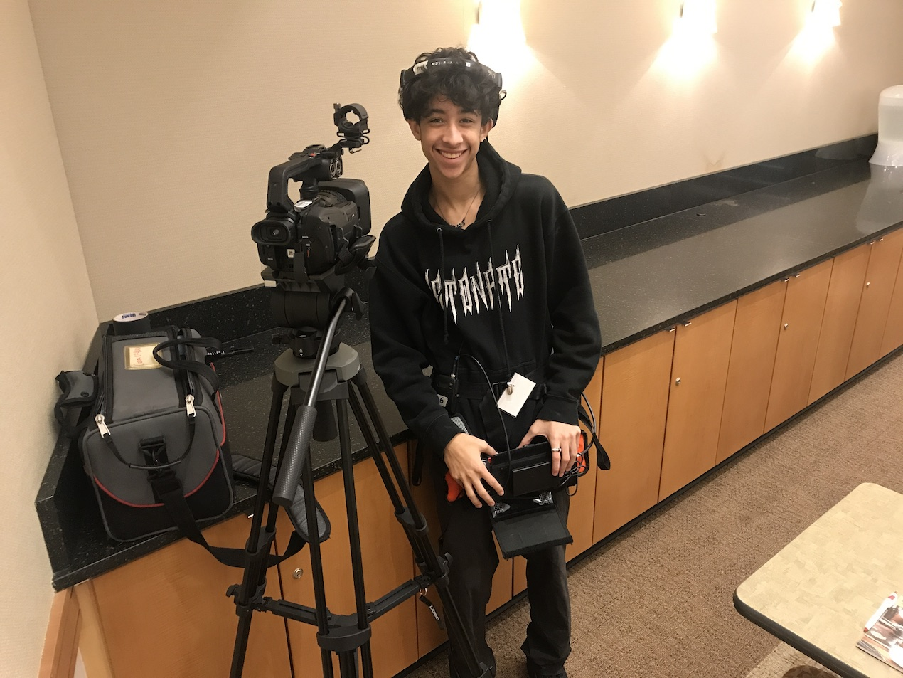 student prepares to film conference
