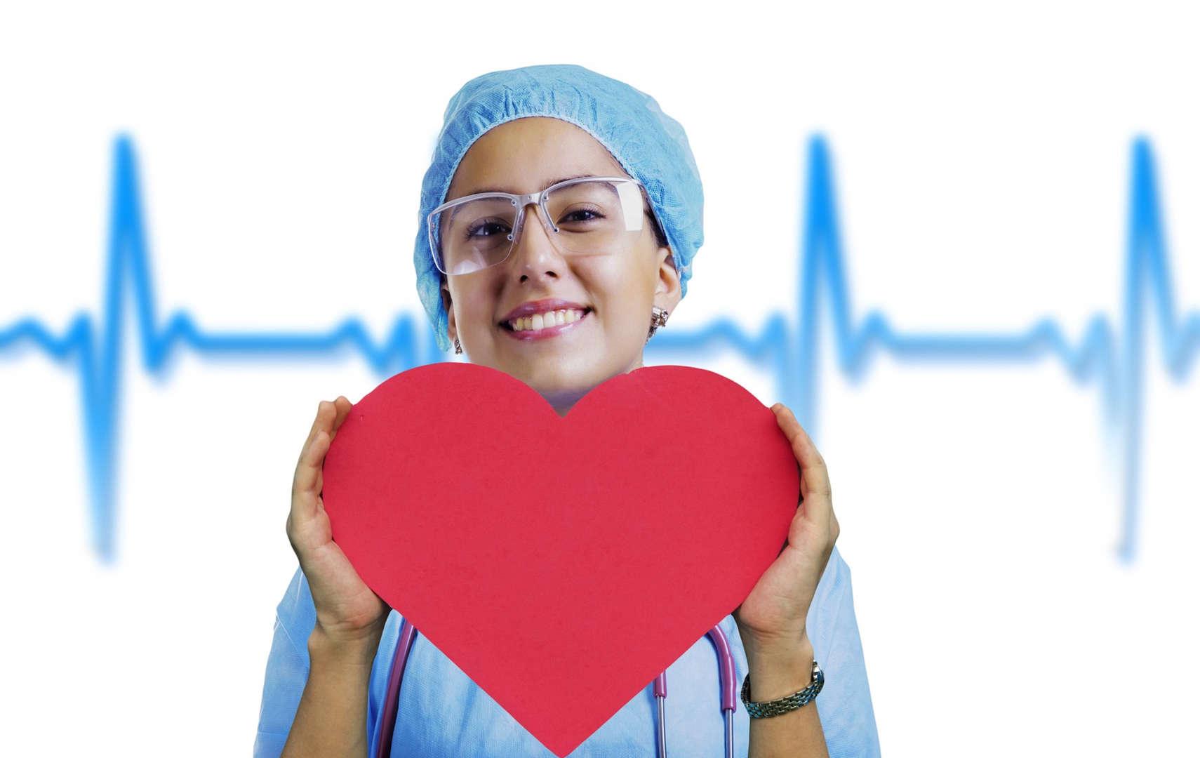 nurse holding up a heart shape