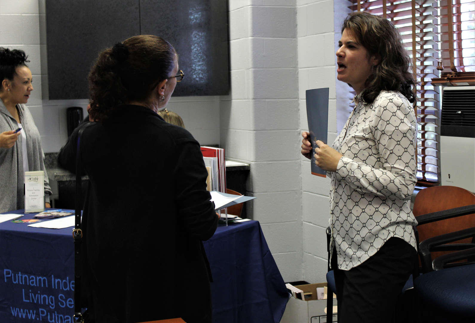 Anne Marie Cellante, president of the SWBOCES SEPTA, speaks with a parent at a recent SEPTA meeting.
