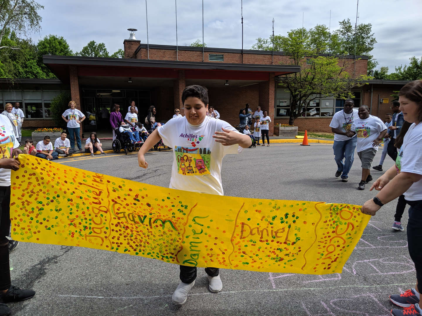 A student is about to break through the banner at the finish line.