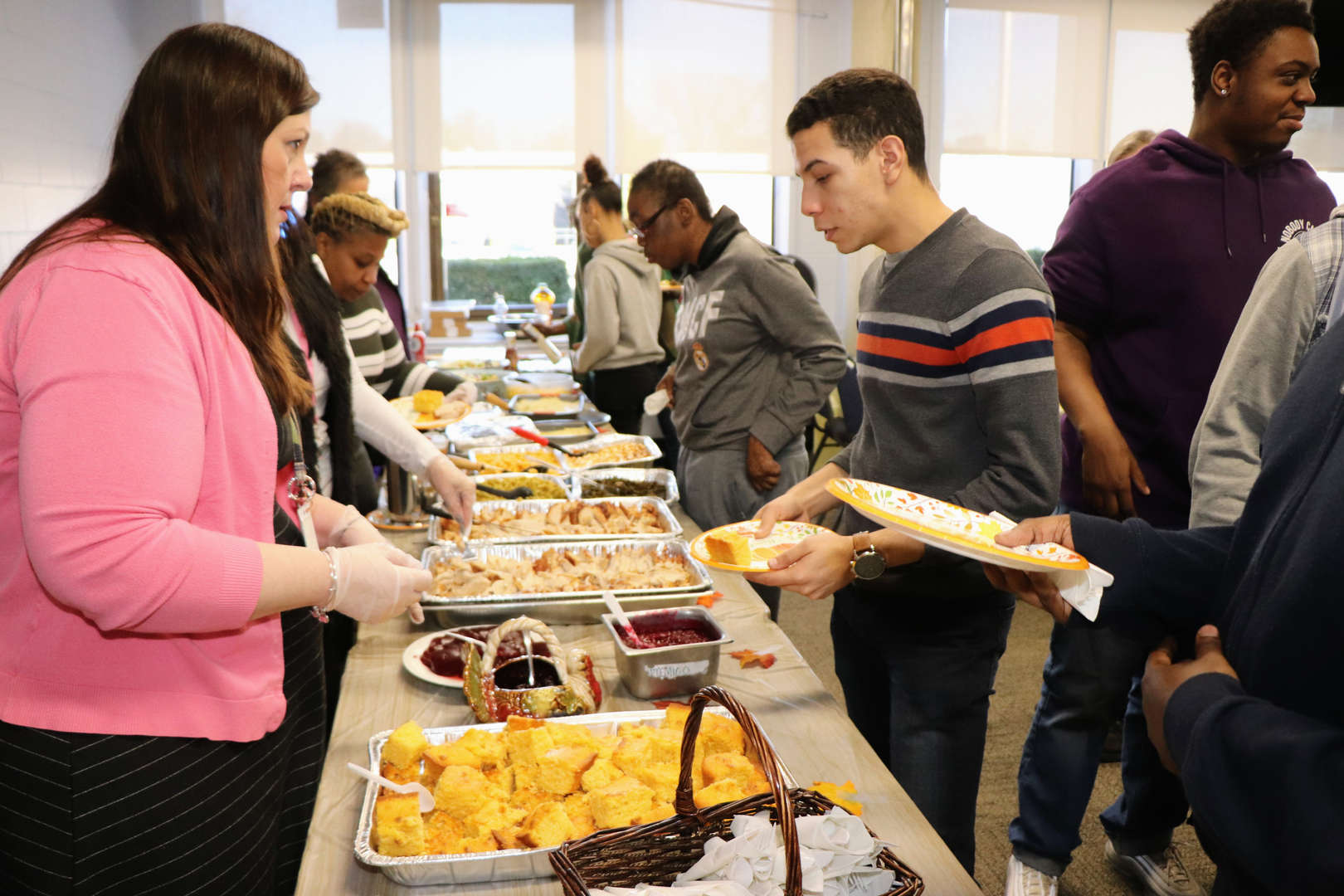 students being served at Thanksgiving luncheon