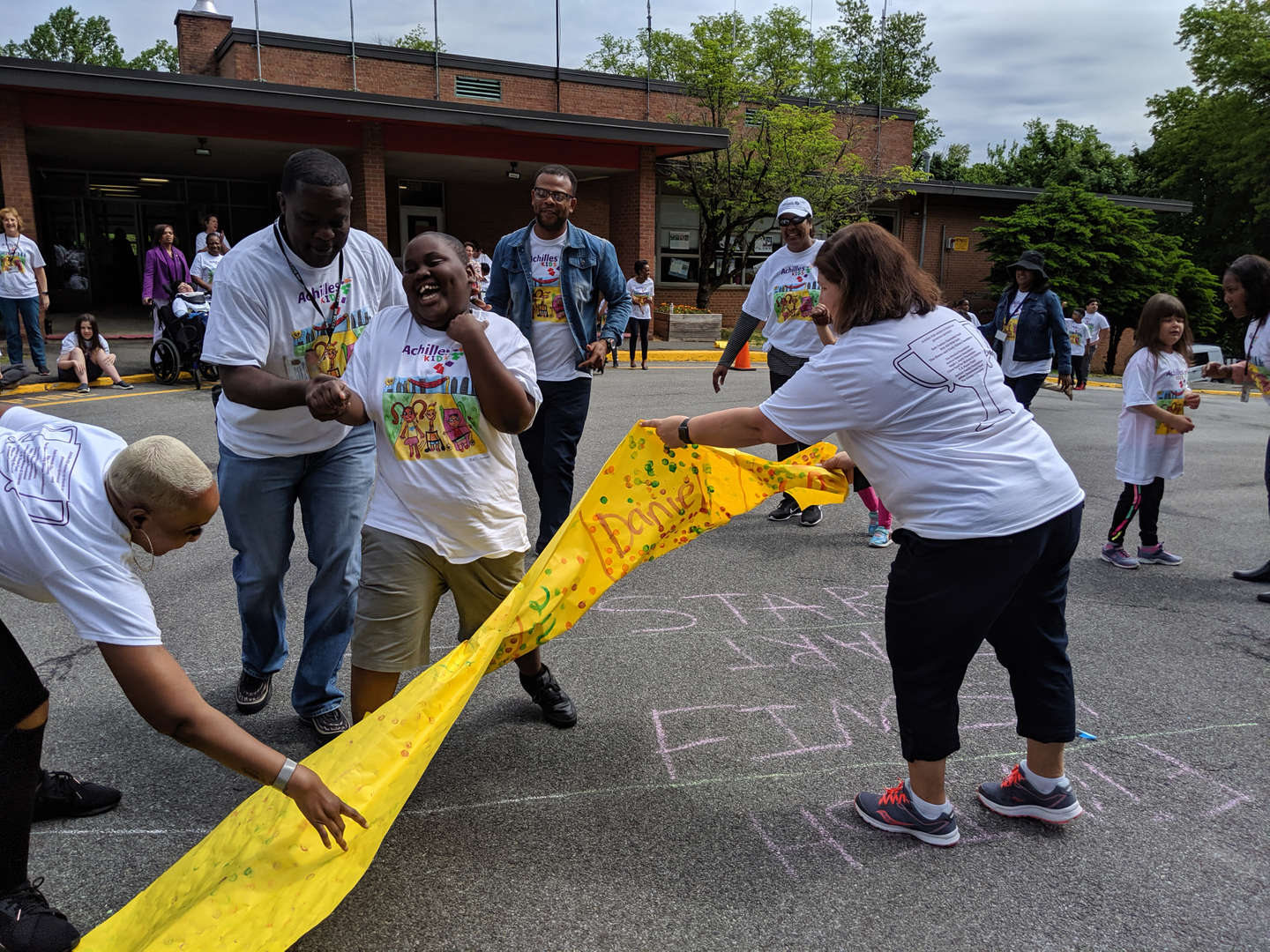 A student breaks  the banner crossing  the finish line.