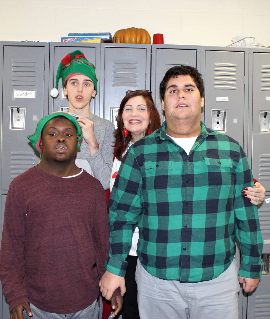 Male students took a photo with their teacher during the holiday singalong at Decagon.