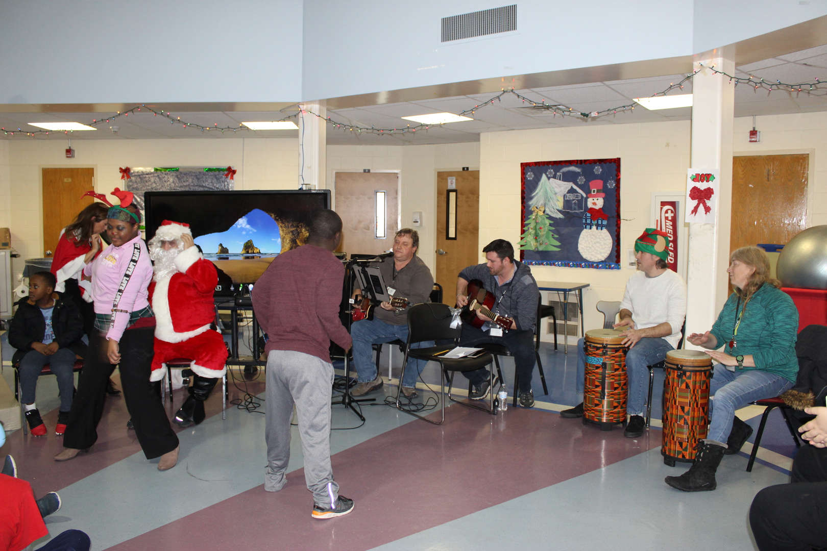 A few students danced as the band played during the holiday singalong at the Decagon.