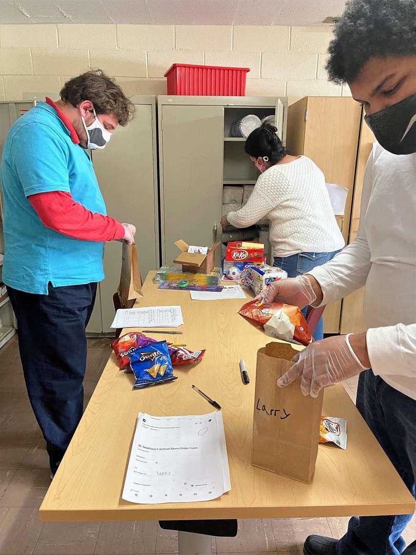 Students help prepare School Store deliveries.