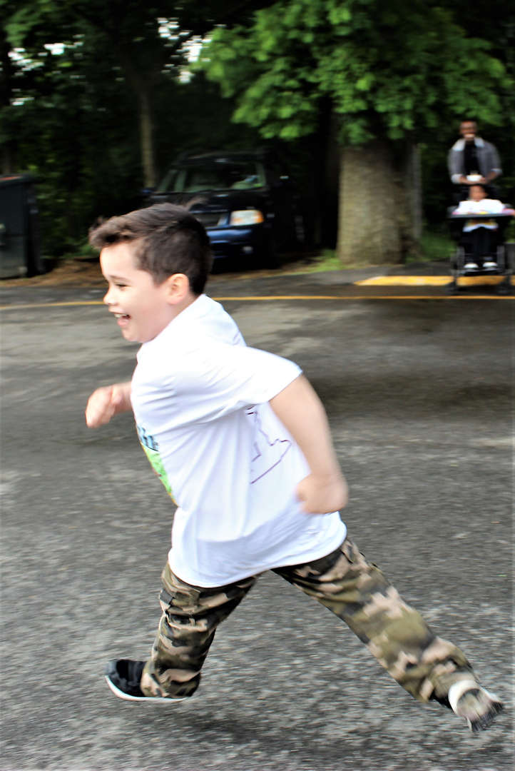 A student runs the last lap of the marathon.