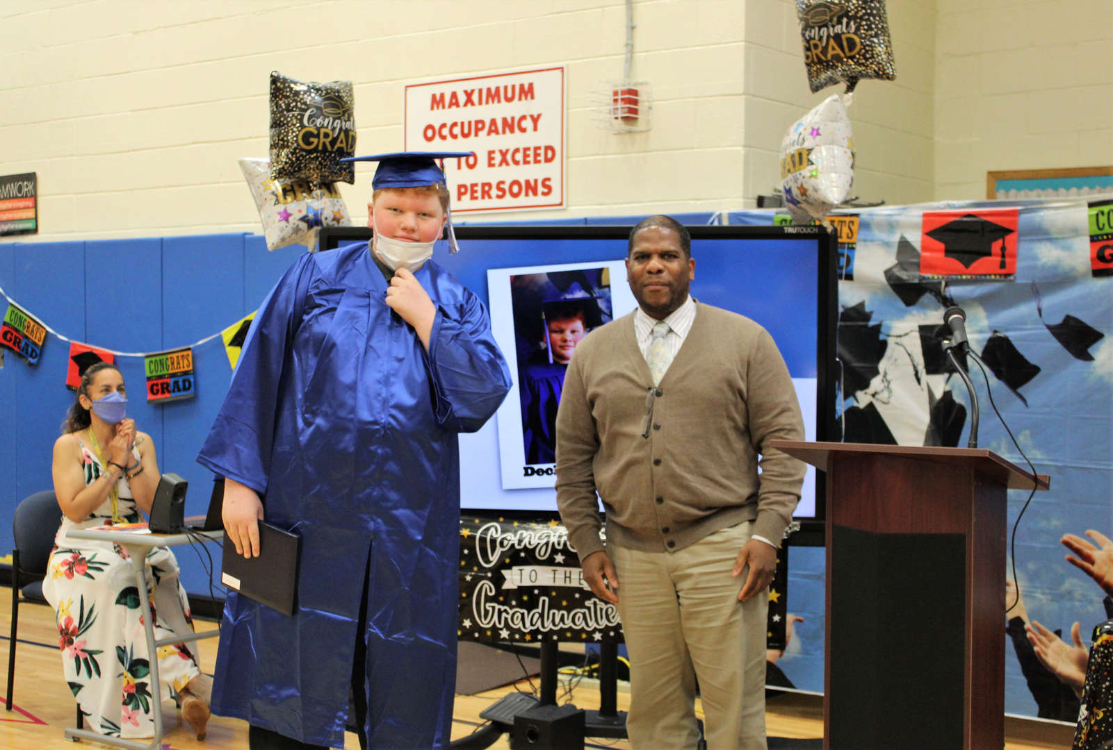 Rye Lake Middle/High School Principal Marvin Elliott poses for a photo with graduate Declan Byrne.