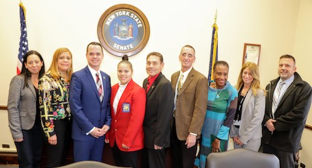 state senator and boces officials and student