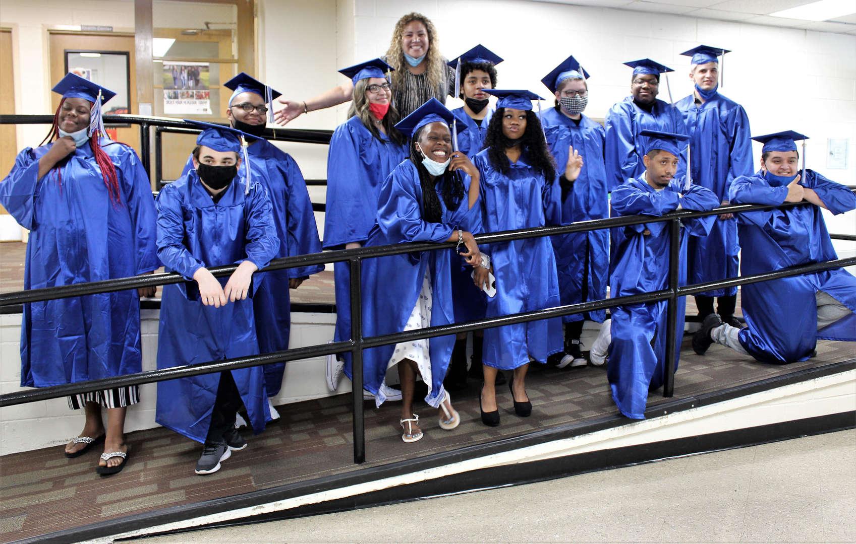 Class of 2021 graduates pose with school counselor Cristina Tompkins June 10.