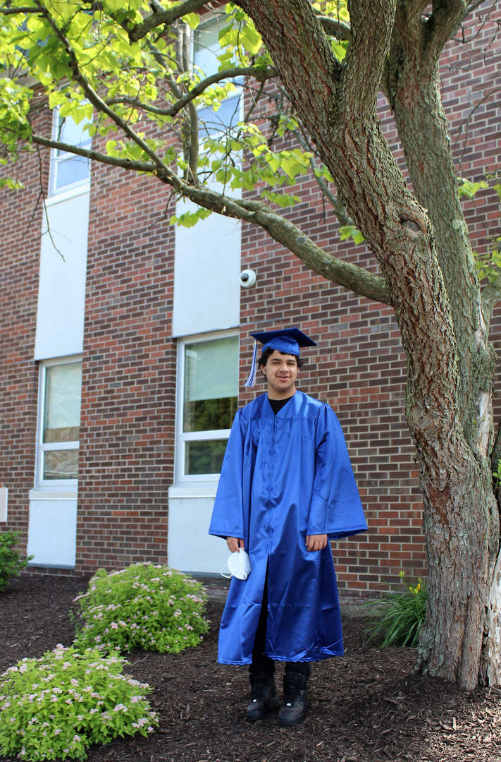 Graduate David Nash poses for a photo outside after the ceremony.