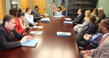 BOCES officials around a table with a legislative aide
