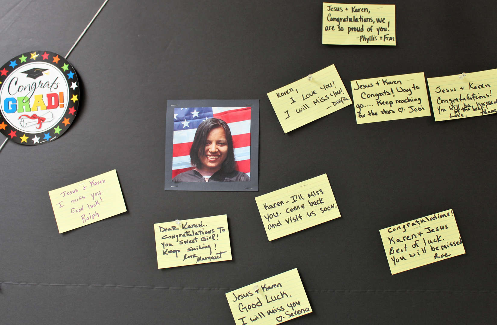 Bulletin board with picture of graduate Karen and congratulatory messages.