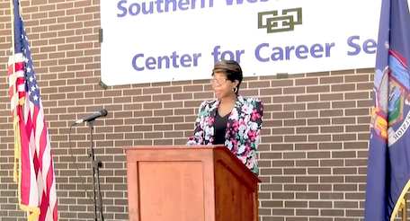 Director Dahlia Jackson speaks at podium during student recognition