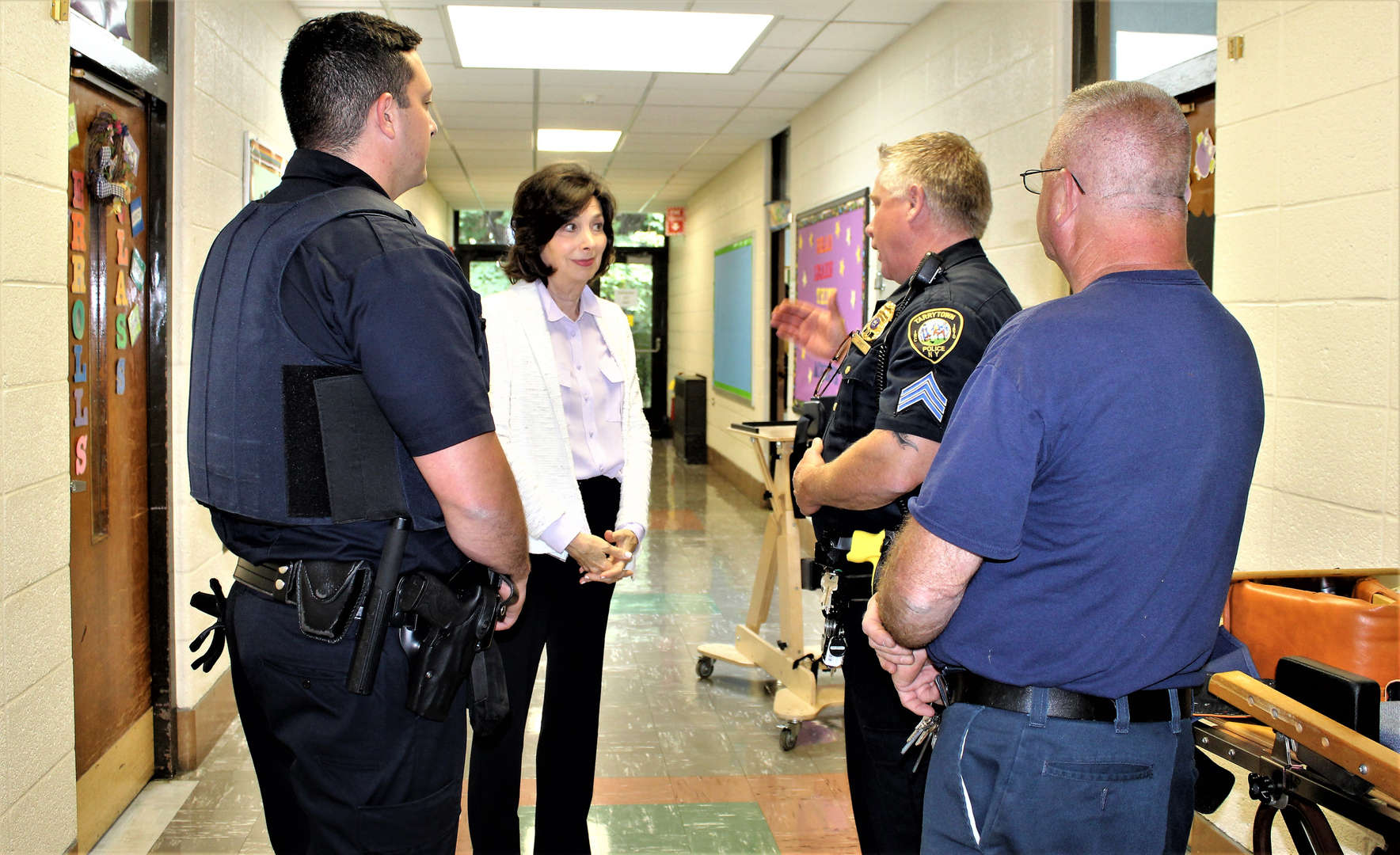 School principal taking police officers on a school tour.