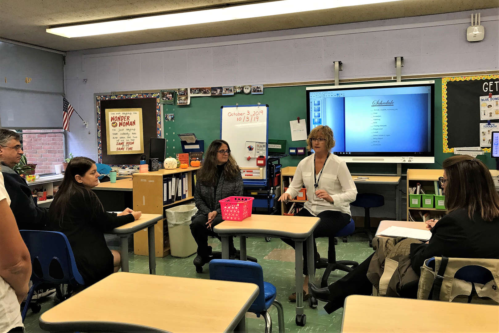 Teacher Kathleen Knudsen speaks with parents during the Tappan Hill Open House.