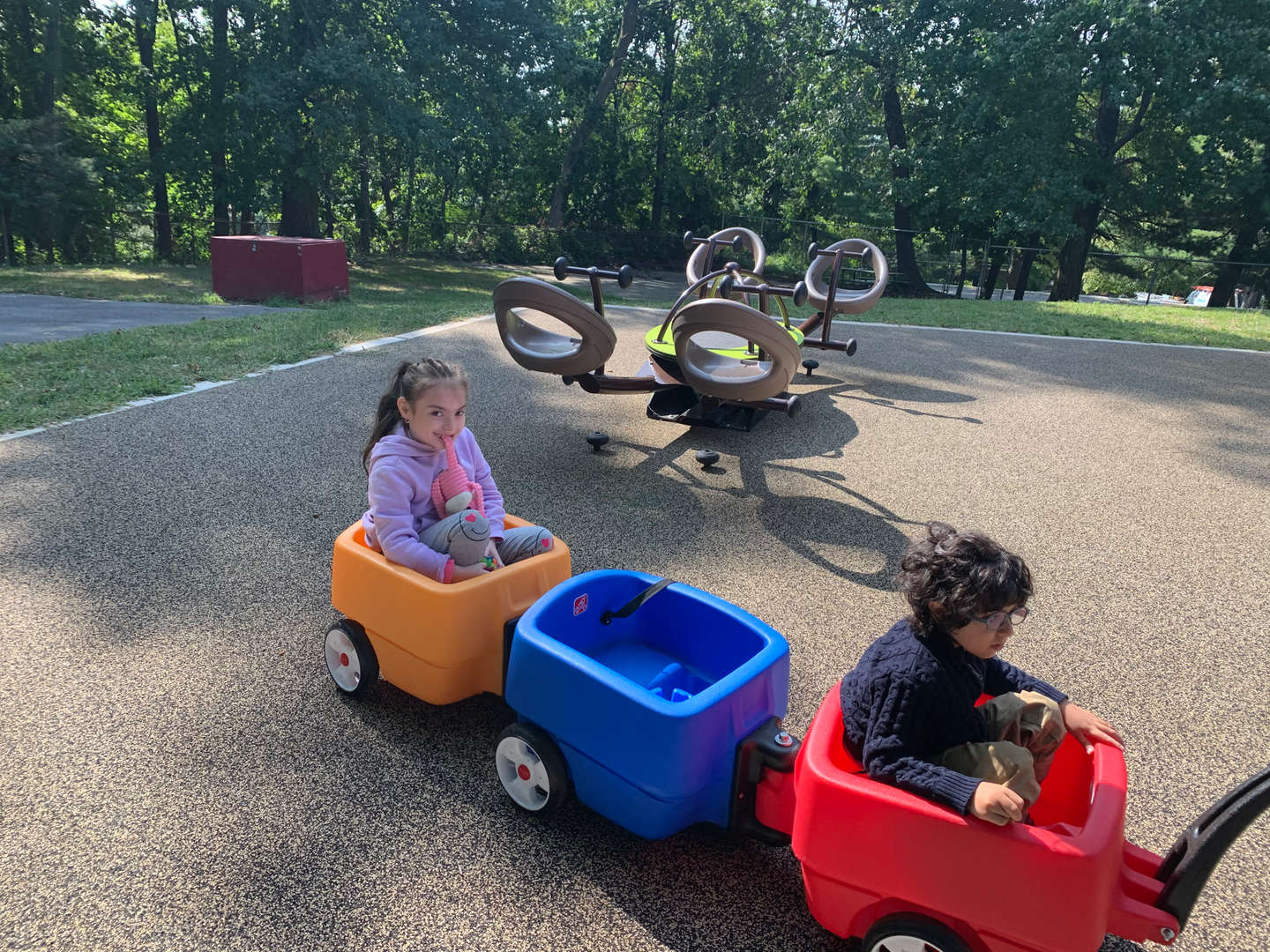 A boy and a girl get a ride in a wagon at Tappan Hill School.