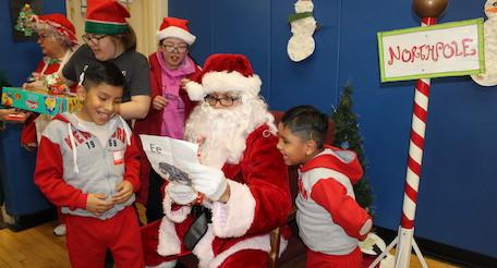 Students meeting Santa at Christmas party
