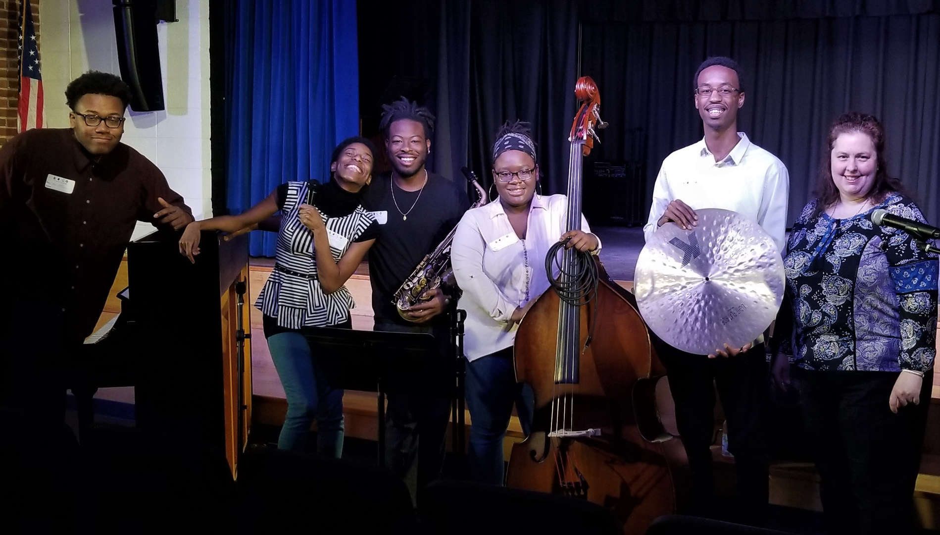 Five musicians pose for a photo with SWBOCES parent Rebecca Charnow.