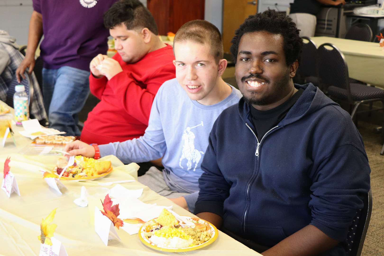 friends smile during Thanksgiving luncheon