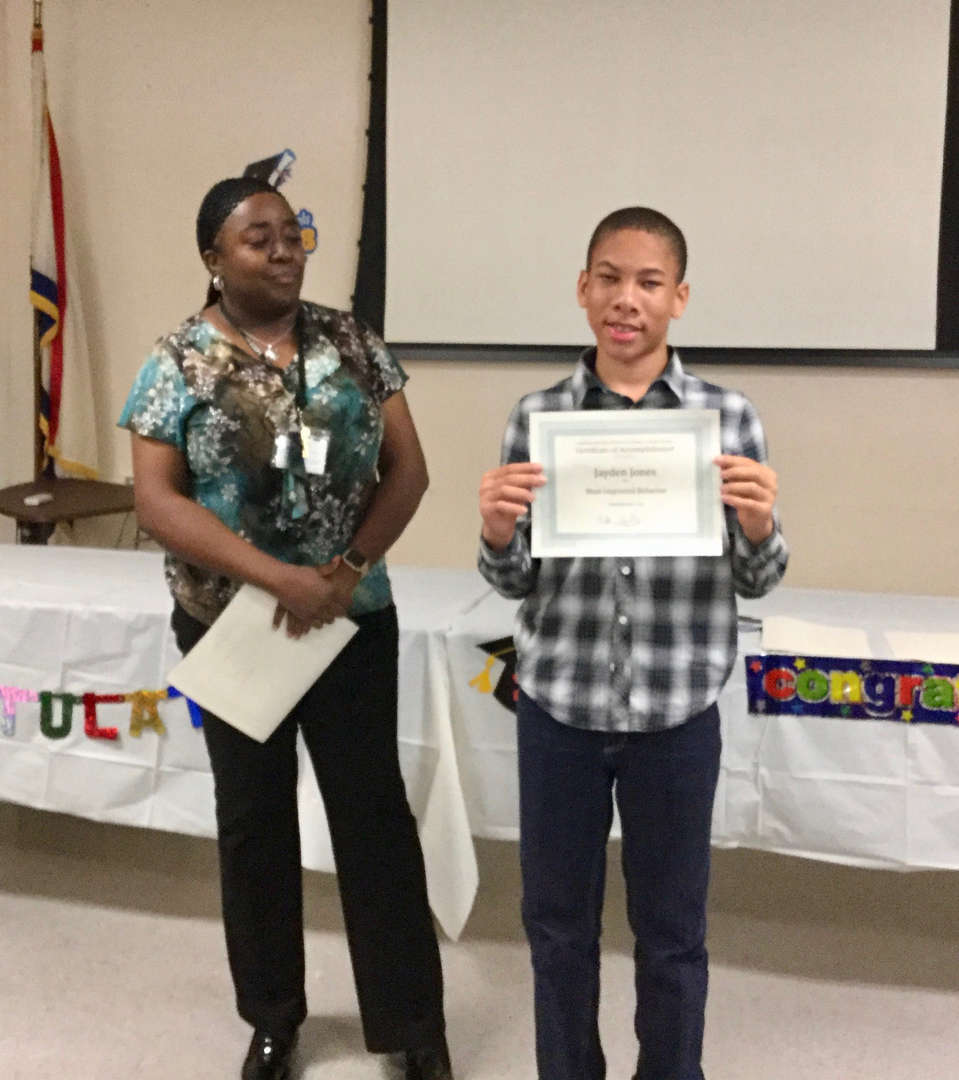 boy with certificate