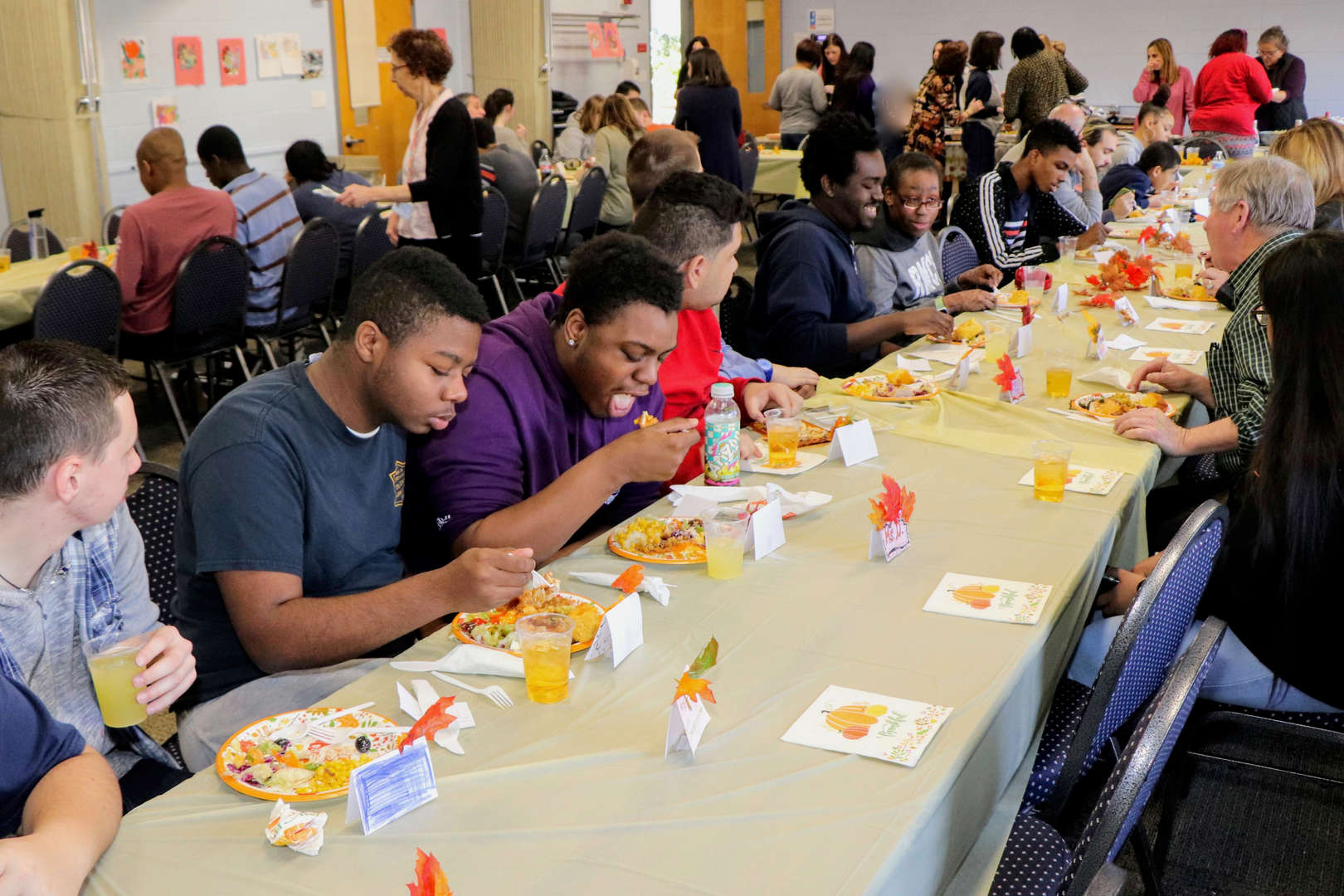 students seated for Thanksgiving luncheon