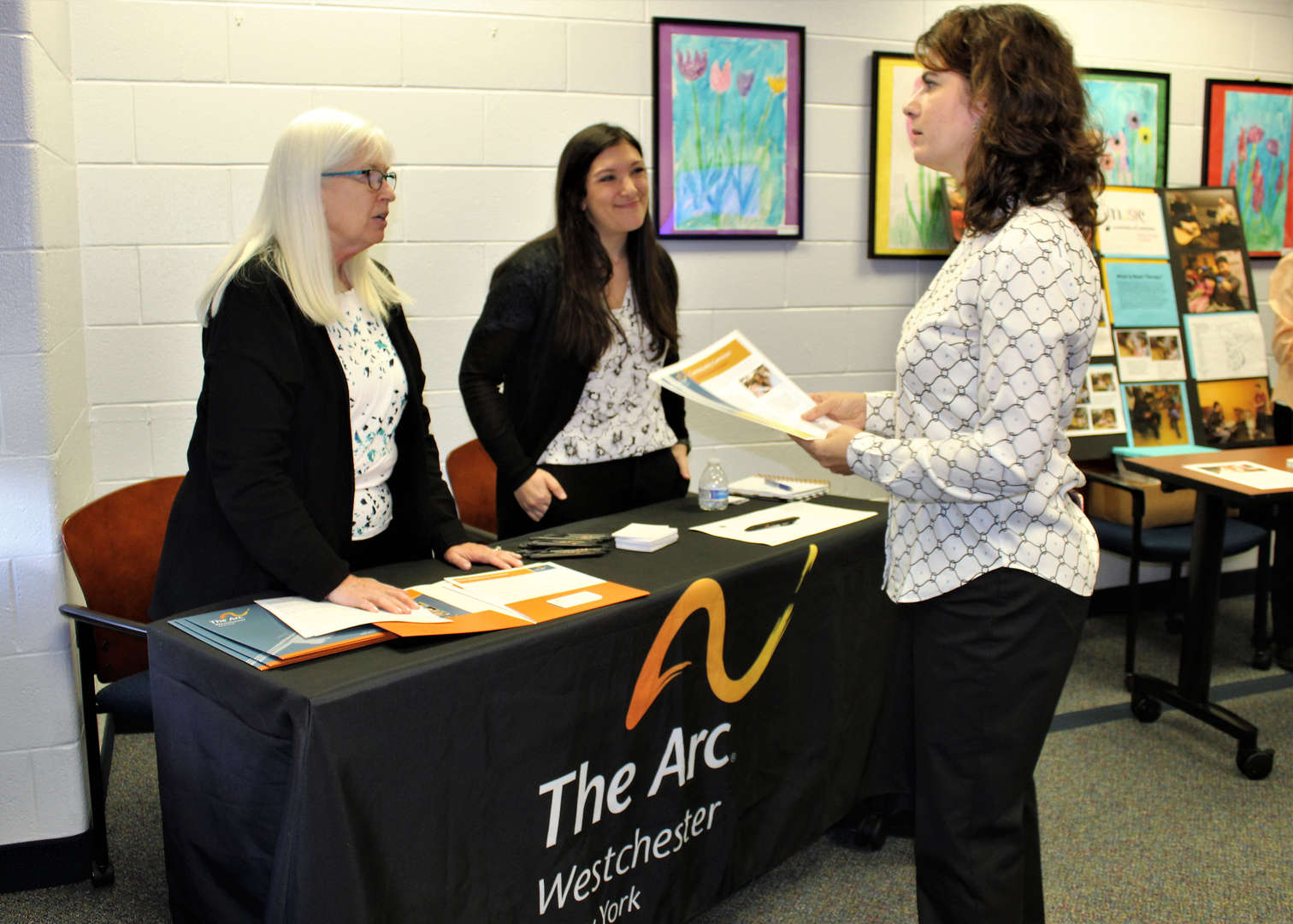 SEPTA President Anne Marie Cellante speaks with Arc Westchester representatives at the recent SEPTA meeting.